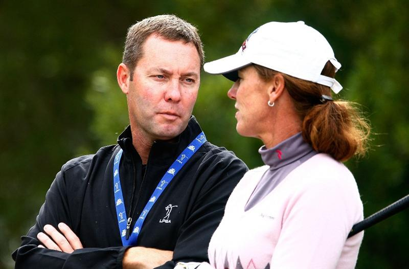 RICHMOND, TX - NOVEMBER 20:  Incoming LPGA Commissioner Michael Whan chats with player Helen Alfredsson during the second round of the LPGA Tour Championship presented by Rolex at the Houstonian Golf and Country Club on November 20, 2009 in Richmond, Texas.  (Photo by Scott Halleran/Getty Images)