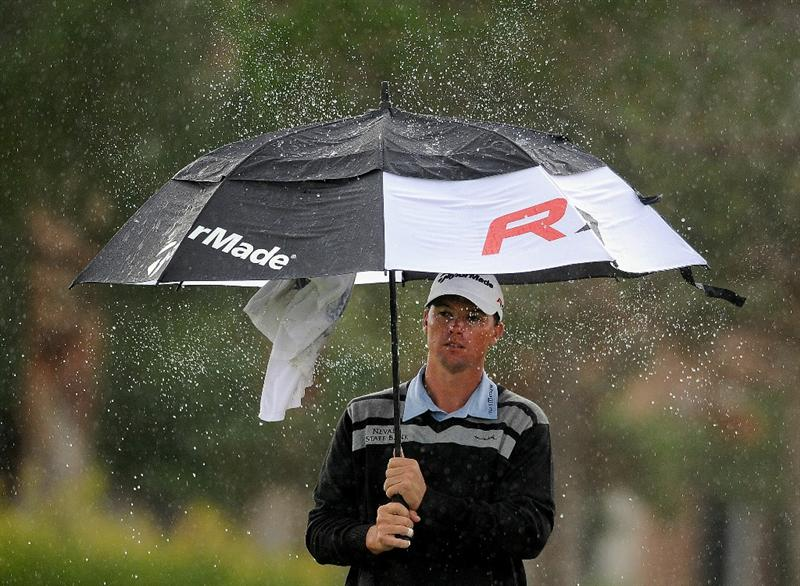 LAS VEGAS, NV - OCTOBER 22: John Mallinger shakes the water off of his umbrella on the 7th hole during the second round of the Justin Timberlake Shriners Hospitals for Children Open on October 22, 2010 in Las Vegas, Nevada. (Photo by Steve Dykes/Getty Images)