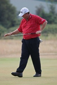 Mark Calcavecchia slaps his putter after a bad shot during the first round of the 135th Open Championship at Royal Liverpool Golf Club in Hoylake, Great Britain on July 20, 2006.Photo by Sam Greenwood/WireImage.com