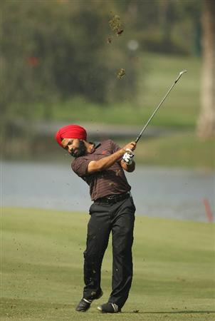 NEW DELHI, INDIA - FEBRUARY 19:  Sujjan Singh of India hits aniron shot during the third round of the Avantha Masters held at The DLF Golf and Country Club on February 19, 2011 in New Delhi, India.  (Photo by Ian Walton/Getty Images)