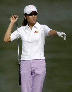 Candie Kung lines up a putt during the first round of the LPGA Florida's Natural Charity Championship on Thursday, April 20, 2006, at EagleOs Landing Country Club in Stockbridge, Georgia.Photo by Grant Halverson/WireImage.com