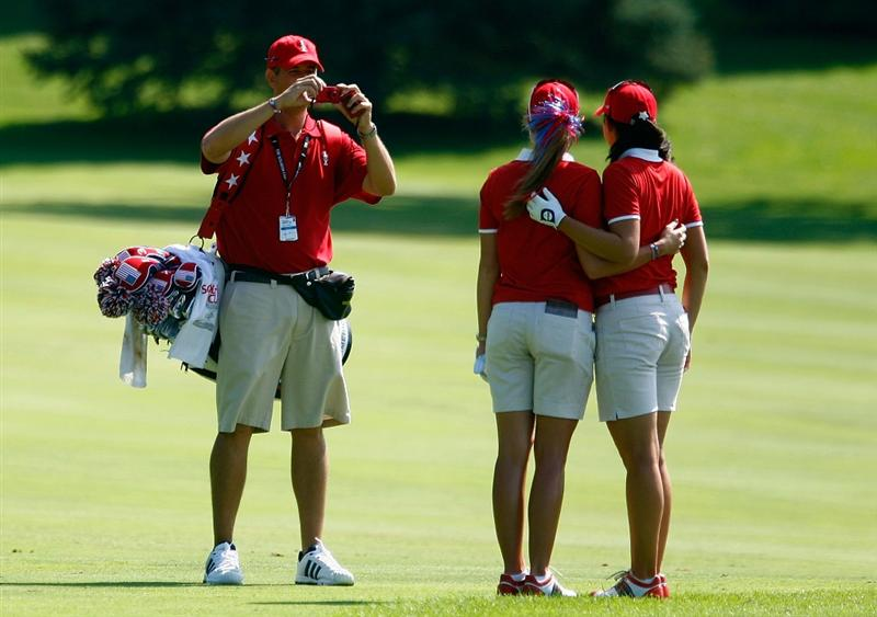 SUGAR GROVE, IL - AUGUST 18:  Craig Castrale of the U.S. Team takes a photo of Paula Creamer and his wife Nicole Castrale during a practice round prior to the start of the 2009 Solheim Cup at Rich Harvest Farms on August 18, 2009 in Sugar Grove, Illinois.  (Photo by Scott Halleran/Getty Images)