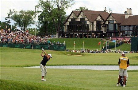 EDINA, MN - JUNE 28:  Stacy Lewis hits her approach shot on the 18th hole as her father/caddie Dale looks on during the third round of the 2008 U.S. Women's Open at Interlachen Country Club on June 28, 2008 in Edina, Minnesota.  (Photo by Scott Halleran/Getty Images)