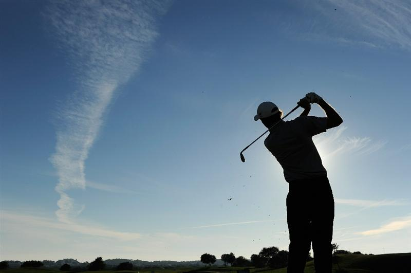 VILAMOURA, PORTUGAL - OCTOBER 17:  Richard Green of Australia hits a shot during the final round of the Portugal Masters at the Oceanico Victoria Golf Course on October 17, 2010 in Vilamoura, Portugal.  (Photo by Stuart Franklin/Getty Images)