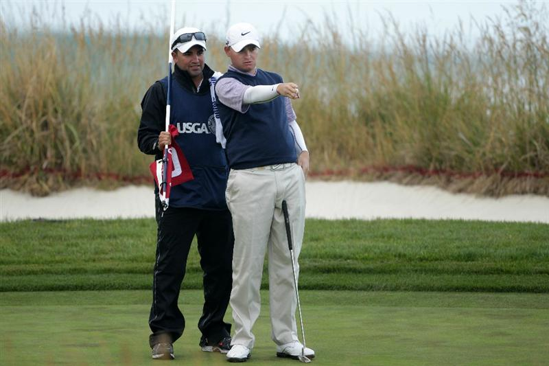 PEBBLE BEACH, CA - JUNE 17:  James Morrison of England (R) and his caddie Sebastian Roberts line up a putt on the tenth green during the first round of the 110th U.S. Open at Pebble Beach Golf Links on June 17, 2010 in Pebble Beach, California.  (Photo by Andrew Redington/Getty Images)