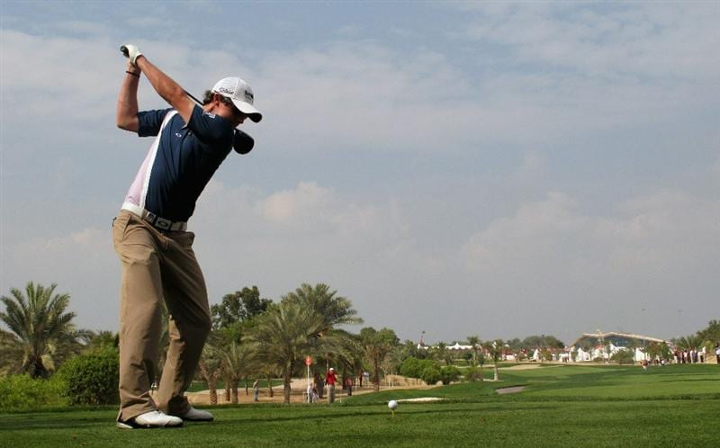 ABU DHABI, UNITED ARAB EMIRATES - JANUARY 23:  Rory McIlroy of Northern Ireland hits his tee-shot on the eighth hole during the final round of The Abu Dhabi HSBC Golf Championship at Abu Dhabi Golf Club on January 23, 2011 in Abu Dhabi, United Arab Emirates.  (Photo by Andrew Redington/Getty Images)