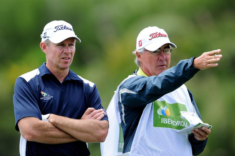MALLORCA, SPAIN - MAY 15:  James Kingston of South Africa and caddie discuss a shot during the third round of the Open Cala Millor Mallorca at Pula golf club on May 15, 2010 in Mallorca, Spain.  (Photo by Stuart Franklin/Getty Images)