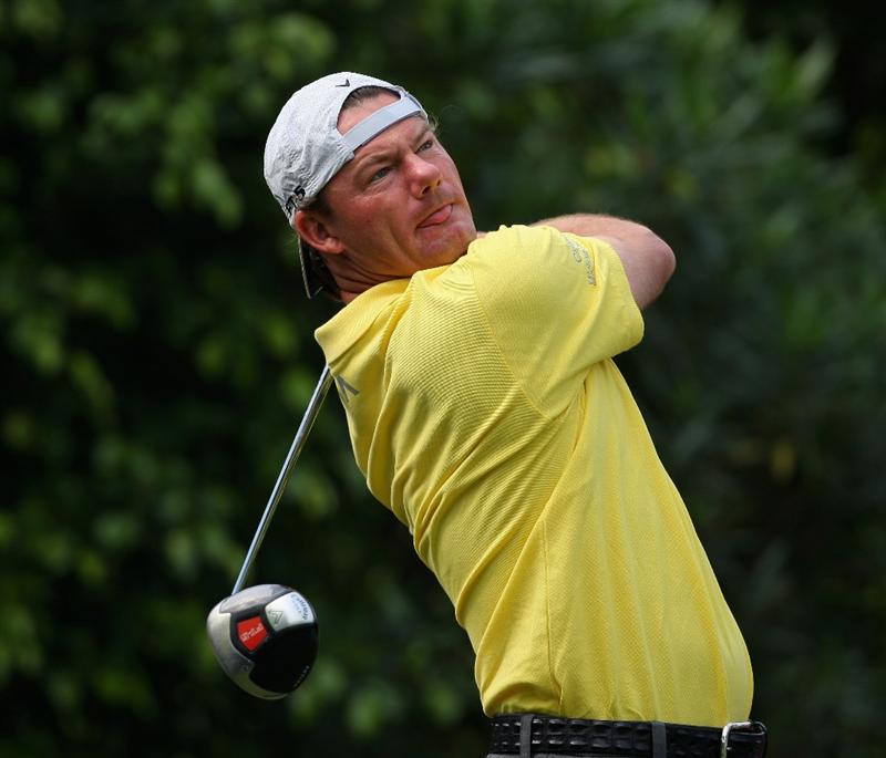 SHENZHEN, CHINA - NOVEMBER 26:  Alex Cejka of Germany plays his approach shot during the pro - am of the Omega Mission Hills World Cup at the Mission Hills Resort on November 26, 2008 in Shenzhen, China.  (Photo by Stuart Franklin/Getty Images)