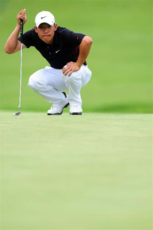 CHASKA, MN - AUGUST 13:  Anthony Kim lines up a putt during the first round of the 91st PGA Championship at Hazeltine National Golf Club on August 13, 2009 in Chaska, Minnesota.  (Photo by Stuart Franklin/Getty Images)