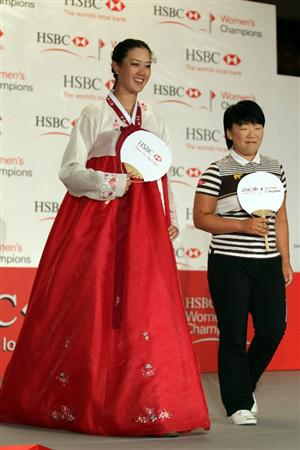 SINGAPORE - FEBRUARY 22:  Michelle Wie of the USA in traditional Korean dress and Jiyai Shin of Korea during a photocall at the Fairmont Hotel prior to the HSBC Women's Champions at Tanah Merah Country Club  on February 22, 2011 in Singapore, Singapore.  (Photo by Ross Kinnaird/Getty Images)