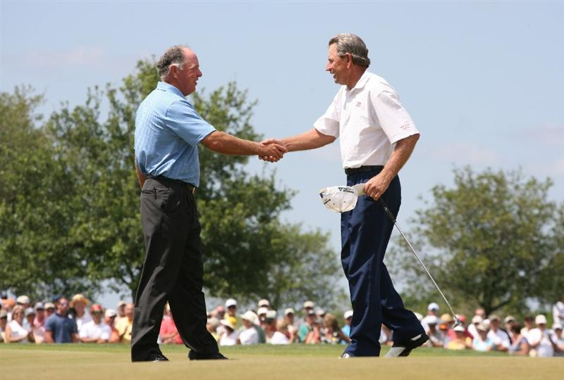 SAVANNAH, GA :  Mark O'Meara (L) shakes hands with playing partner Nick Price (R) of South Africa on the 18th hole during the final round of the Liberty Mutual Legends of Golf at the Westin Savannah Harbor Golf Resort and Spa on April 26, 2009 in Savannah, Georgia. (Photo by Hunter Martin/Getty Images)