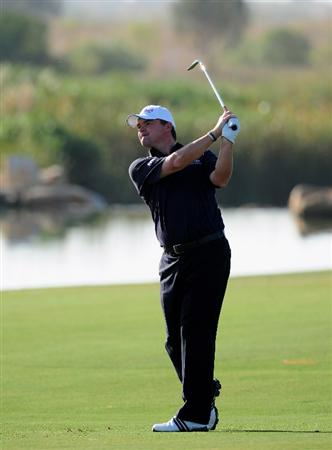 VILAMOURA, PORTUGAL - OCTOBER 15:  Paul Lawrie of Scotland plays his approach shot on the 17th hole during the first round of the Portugal Masters at the Oceanico Victoria Golf Course on October 15, 2009 in Vilamoura, Portugal.  (Photo by Stuart Franklin/Getty Images)