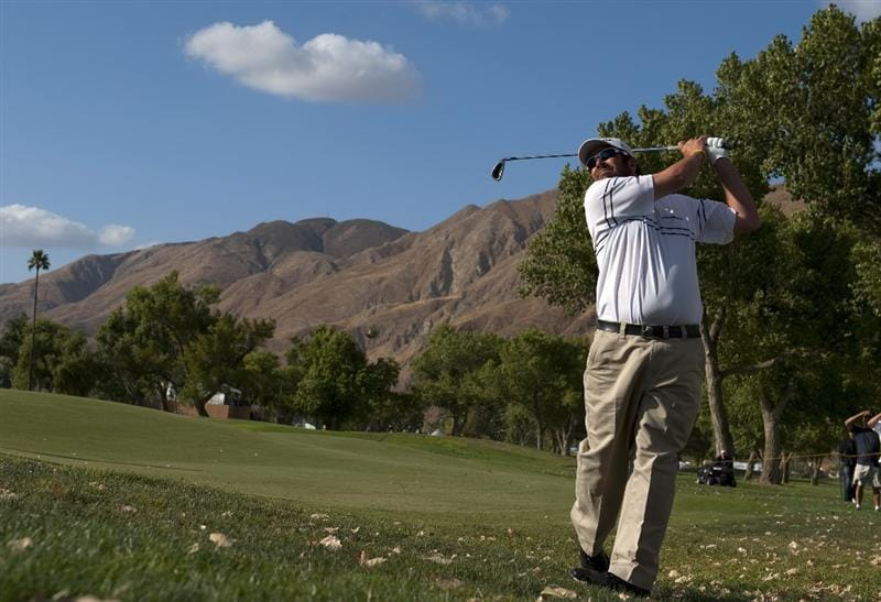 SAN JACINTO, CA - OCTOBER 04: Jerod Turner makes an approach shot on the 14th hole during the final round of the 2009 Soboba Classic at The Country Club at Soboba Springs on October 4, 2009 in San Jacinto, California. (Photo by Robert Laberge/Getty Images)