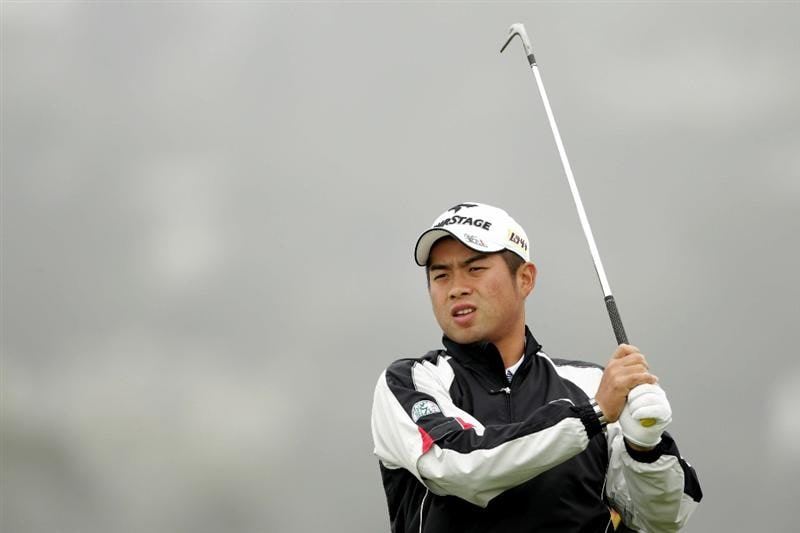 PEBBLE BEACH, CA - JUNE 14:  Yuta Ikeda of Japan watches a shot during a practice round prior to the start of the 110th U.S. Open at Pebble Beach Golf Links on June 14, 2010 in Pebble Beach, California.  (Photo by Andrew Redington/Getty Images)