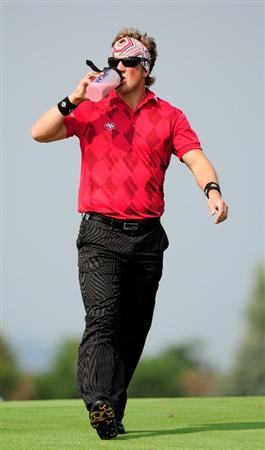 VIENNA, AUSTRIA - SEPTEMBER 19:  Pelle Edberg of Sweden drinks a protein shake as he walks down the 6th fairway during the third round of the Austrian Golf Open at Fontana Golf Club on September 19, 2009 in Vienna, Austria.  (Photo by Richard Heathcote/Getty Images)