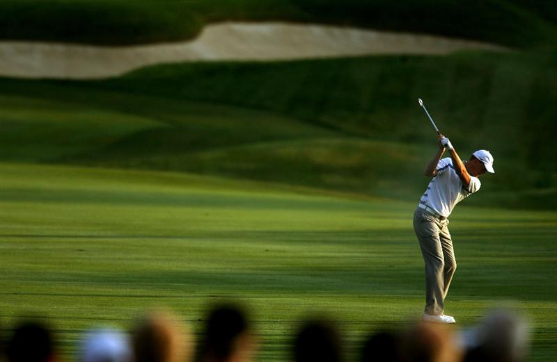 LOUISVILLE, KY - SEPTEMBER 19:  Robert Karlsson of the European team hits his approach shot on the first hole during the morning foursomes on day one of the 2008 Ryder Cup at Valhalla Golf Club on September 19, 2008 in Louisville, Kentucky.  (Photo by Andy Lyons/Getty Images)