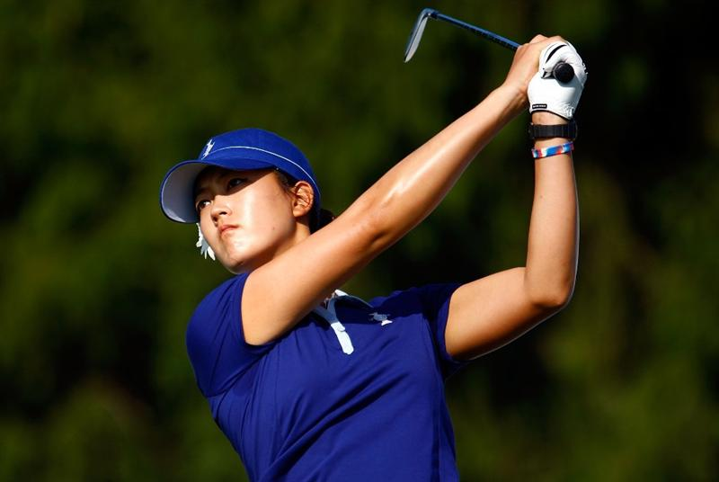 SUGAR GROVE, IL - AUGUST 19:  Michelle Wie of the U.S. Team hits a shot during a practice round prior to the start of the 2009 Solheim Cup at Rich Harvest Farms on August 19, 2009 in Sugar Grove, Illinois.  (Photo by Scott Halleran/Getty Images)