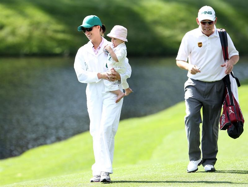 AUGUSTA, GA - APRIL 06:  Louis Oosthuizen of South Africa (R) walks with wife Nel-Mare and daughter Jana during the Par 3 Contest prior to the 2011 Masters Tournament at Augusta National Golf Club on April 6, 2011 in Augusta, Georgia.  (Photo by Andrew Redington/Getty Images)
