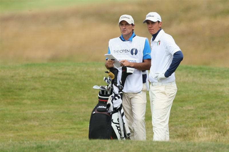 TURNBERRY, SCOTLAND - JULY 18:  Matteo Manassero (R) (Amateur) of Italy discusses a shot with caddy Alberto Binagh during round three of the 138th Open Championship on the Ailsa Course, Turnberry Golf Club on July 18, 2009 in Turnberry, Scotland.  (Photo by David Cannon/Getty Images)