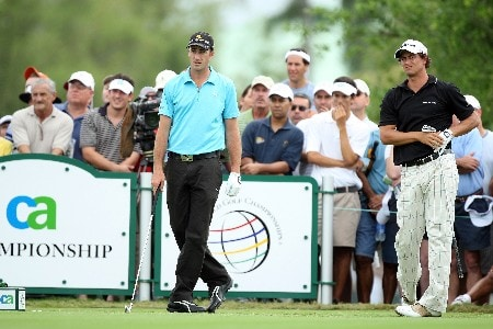 MIAMI - MARCH 22:  Adam Scott of Australia tees off at the 4th hole as Geoff Ogilvy of Australia follows him onto the tee during the third round of the 2008 World Golf Championships CA Championship at the Doral Golf Resort & Spa, on March 22, 2008 in Miami, Florida.  (Photo by David Cannon/Getty Images)