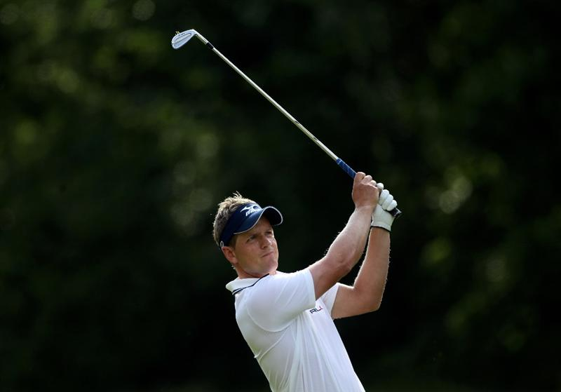 VIRGINIA WATER, ENGLAND - MAY 29:  Luke Donald of England plays his second shot into the 16th hole during the final round of the BMW PGA Championship  at the Wentworth Club on May 29, 2011 in Virginia Water, England.  (Photo by Warren Little/Getty Images)