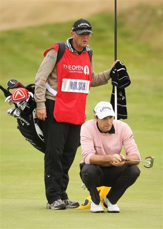 TURNBERRY, SCOTLAND - JULY 18:   Oliver Wilson of England lines up a putt with his caddie Richard Hill during round three of the 138th Open Championship on the Ailsa Course, Turnberry Golf Club on July 18, 2009 in Turnberry, Scotland.  (Photo by Andrew Redington/Getty Images)