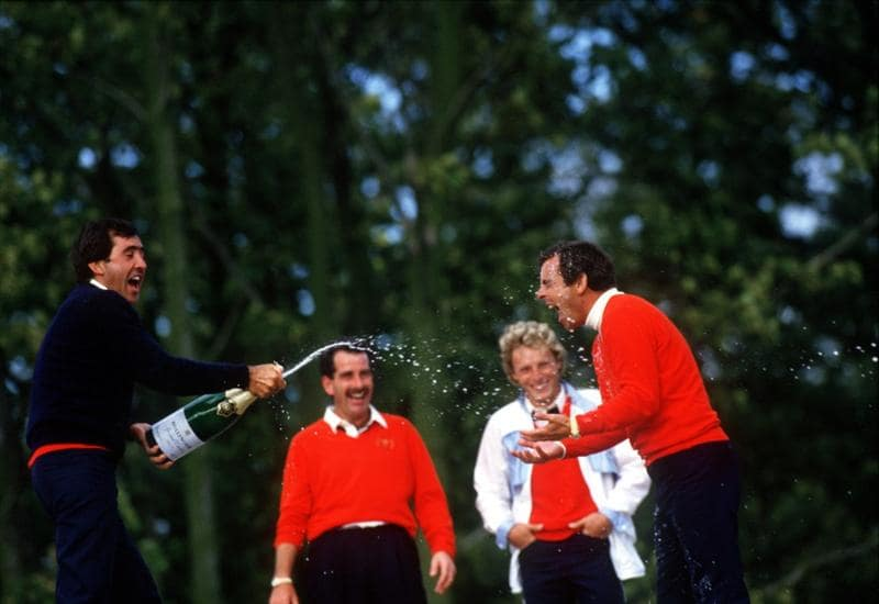Sep 1985:  Severiano Ballesteros sprays Tony Jacklin with Champagne as Bernhard Langer and Sam Torrance look on after winning the Ryder Cup played at The Belfry Golf Club, Sutton Coldfield. Mandatory Credit: Allsport UK/Getty Images