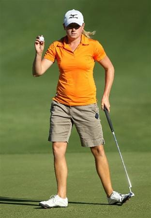 RANCHO MIRAGE, CA - APRIL 01:  Stacy Lewis holds up jer ball after making a birdie on the second hole during the second round of the Kraft Nabisco Championship at Mission Hills Country Club on April 1, 2011 in Rancho Mirage, California.  (Photo by Stephen Dunn/Getty Images)