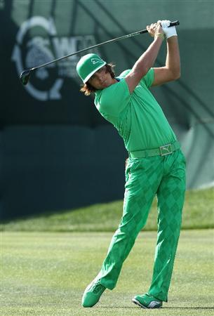 SCOTTSDALE, AZ - FEBRUARY 05:  Rickie Fowler hits a tee shot on the first hole during the second round of the Waste Management Phoenix Open at TPC Scottsdale on February 5, 2011 in Scottsdale, Arizona.  (Photo by Christian Petersen/Getty Images)