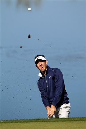 MARANA, AZ - FEBRUARY 24:  Charl Schwartzel of South Africa hits a shot on the green of the third hole during the second round of the Accenture Match Play Championship at the Ritz-Carlton Golf Club on February 24, 2011 in Marana, Arizona.  (Photo by Sam Greenwood/Getty Images)