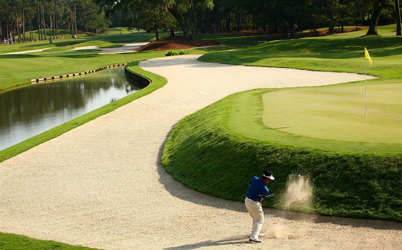 PONTE VEDRA BEACH, FL - MAY 07:  K.J. Choi of South Korea plays a shot from a greenside bunker on the 11th hole during the first round of THE PLAYERS Championship on THE PLAYERS Stadium Course at TPC Sawgrass on May 7, 2009 in Ponte Vedra Beach, Florida.  (Photo by Scott Halleran/Getty Images)