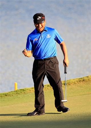 PONTE VEDRA BEACH, FL - MAY 15:  K.J. Choi of South Korea celebrates making birdie on the 17th hole during the final round of THE PLAYERS Championship held at THE PLAYERS Stadium course at TPC Sawgrass on May 15, 2011 in Ponte Vedra Beach, Florida.  (Photo by Sam Greenwood/Getty Images)
