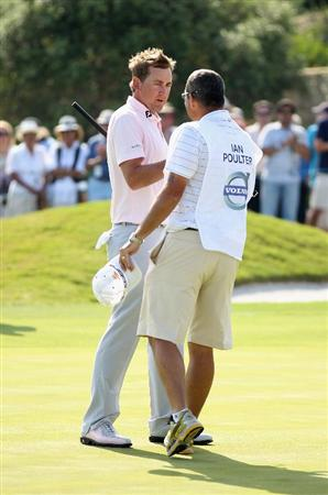 CASARES, SPAIN - MAY 22:  Ian Poulter of England celebrates with his caddie Terry Mundy after winning the Volvo World Match Play Championship at Finca Cortesin on May 22, 2011 in Casares, Spain.  (Photo by Warren Little/Getty Images)