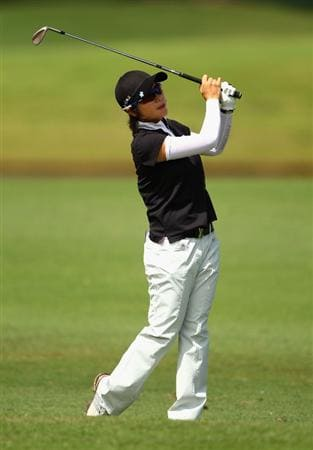 GOLD COAST, AUSTRALIA - MARCH 04:  Eun Hee Ji of Korea plays an iron shot on the 8th hole during round one of the 2010 ANZ Ladies Masters at Royal Pines Resort on March 4, 2010 in Gold Coast, Australia.  (Photo by Ryan Pierse/Getty Images)