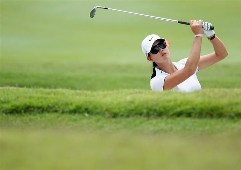 SINGAPORE - FEBRUARY 25:  Michelle Wie of the USA plays a bunker shot on the 17th hole during the second round of the HSBC Women's Champions 2011 at the Tanah Merah Country Club on February 25, 2011 in Singapore, Singapore.  (Photo by Scott Halleran/Getty Images)
