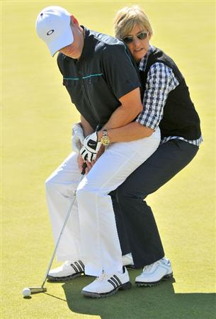 LAS VEGAS - OCTOBER 15: Ellen DeGeneres helps amateur golfer Kevins Hooks with his putting during the Championship Pro-Am of the Justin Timberlake Shriners Hospitals for Children Open held at the TPC Summerlin on October 15, 2008 in Las Vegas, Nevada. (Photo by Marc Feldman\Getty Images)