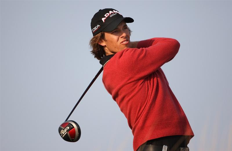DOHA, QATAR - JANUARY 23:  Aaron Baddeley of Australia watches his tee-shot on the 16th hole during the second round of  the Commercialbank Qatar Masters at Doha Golf Club on January 23, 2009 in Doha, Qatar.  (Photo by Andrew Redington/Getty Images)