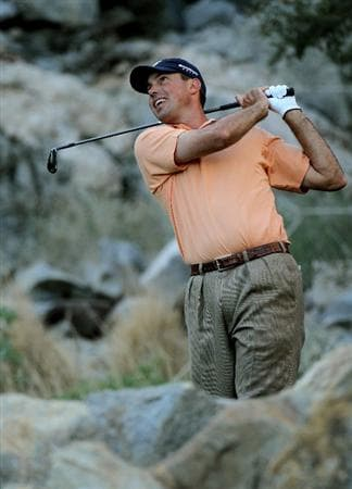 LA QUINTA, CA - JANUARY 25:  Matt Kuchar hits his tee shot on the 17th hole at the Palmer Private course at PGA West during the final round of the Bob Hope Classic on January 25, 2010 in La Quinta, California.  (Photo by Stephen Dunn/Getty Images)