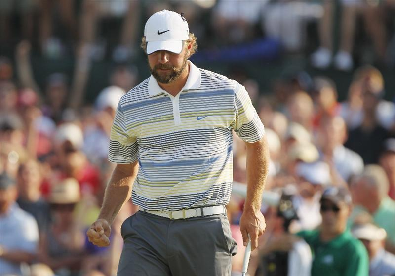 CHARLOTTE, NC - MAY 08:  Lucas Glover celebrates his par saving putt on the 18th green during the final round of the Wells Fargo Championship at the Quail Hollow Club on May 8, 2011 in Charlotte, North Carolina.  (Photo by Scott Halleran/Getty Images)