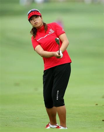 HAVRE DE GRACE, MD - JUNE 11:  Shanshan Feng of China hits her third shot on the 8th hole during the first round of the McDonald's LPGA Championship at Bulle Rock Golf Course on June 11, 2009 in Havre de Grace, Maryland.  (Photo by Andy Lyons/Getty Images)
