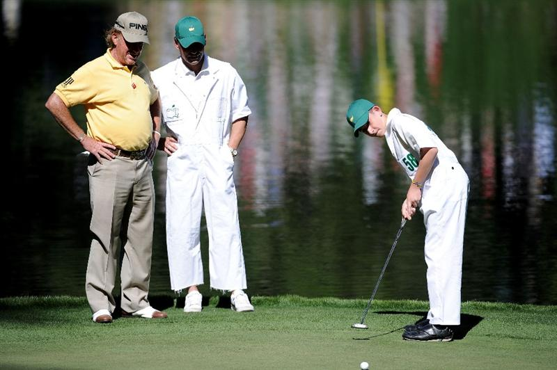 AUGUSTA, GA - APRIL 06:  Miguel Angel Jimenez of Spain (L) waits with his caddie and leading matador Pepin Liria (C) as his son Victor (R) hits a putt during the Par 3 Contest prior to the 2011 Masters Tournament at Augusta National Golf Club on April 6, 2011 in Augusta, Georgia.  (Photo by Harry How/Getty Images)