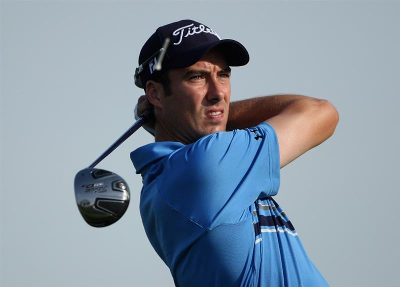 DUBAI, UNITED ARAB EMIRATES - NOVEMBER 20:  Ross Fisher of England hits his tee-shot on the second hole during the second round of the Dubai World Championship on the Earth Course, Jumeirah Golf Estates on November 20, 2009 in Dubai, United Arab Emirates.  (Photo by Andrew Redington/Getty Images)