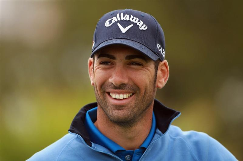 BAHRAIN, BAHRAIN - JANUARY 26:  Alvaro Quiros of Spain smiles during the Pro Am prior to the start of the Volvo Golf Champions at The Royal Golf Club on January 26, 2011 in Bahrain, Bahrain.  (Photo by Andrew Redington/Getty Images)