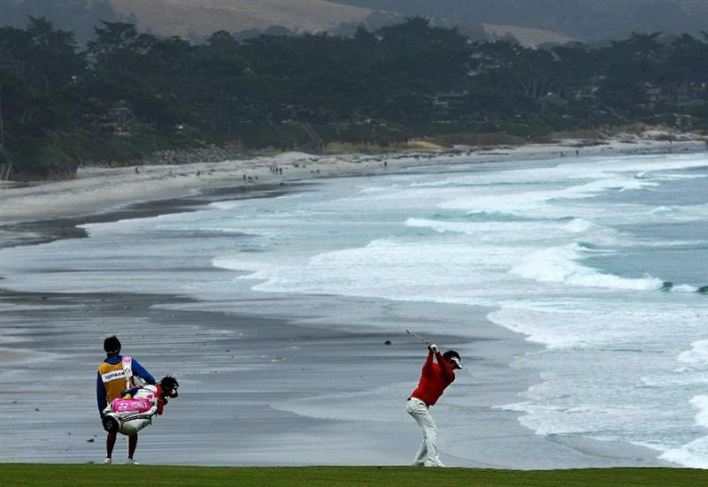 PEBBLE BEACH, CA - JUNE 18:  Ryo Ishikawa of Japan (R) hits a shot on the ninth hole while his caddie Hiroyuki Kato looks on during the second round of the 110th U.S. Open at Pebble Beach Golf Links on June 18, 2010 in Pebble Beach, California.  (Photo by Donald Miralle/Getty Images)