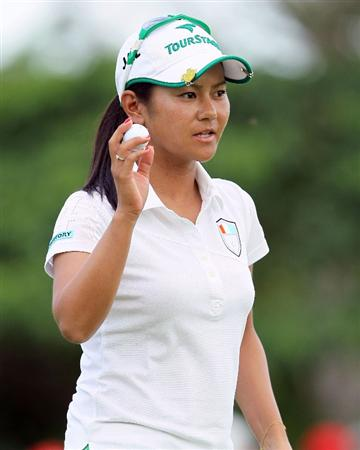 SINGAPORE - FEBRUARY 25:  Ai Miyazato of Japan waves to the crowd after making her par putt on the 18th hole during the first round of the HSBC Women's Champions at Tanah Merah Country Club on February 25, 2010 in Singapore, Singapore.  (Photo by Andy Lyons/Getty Images)