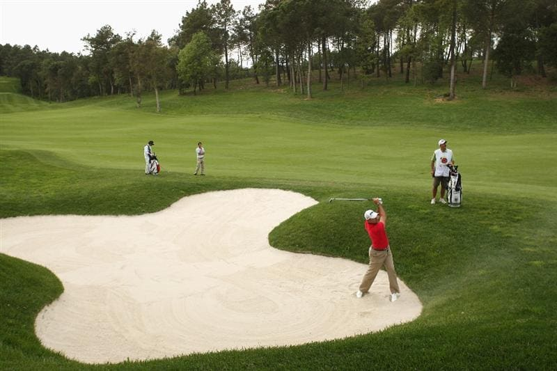 GIRONA, SPAIN - APRIL 30:  Anthony Snobeck of France plays out of the seventh fairway bunker during the first round of the Open de Espana at the PGA Golf Catalunya on April 30, 2009 in Girona, Spain.  (Photo by Warren Little/Getty Images)