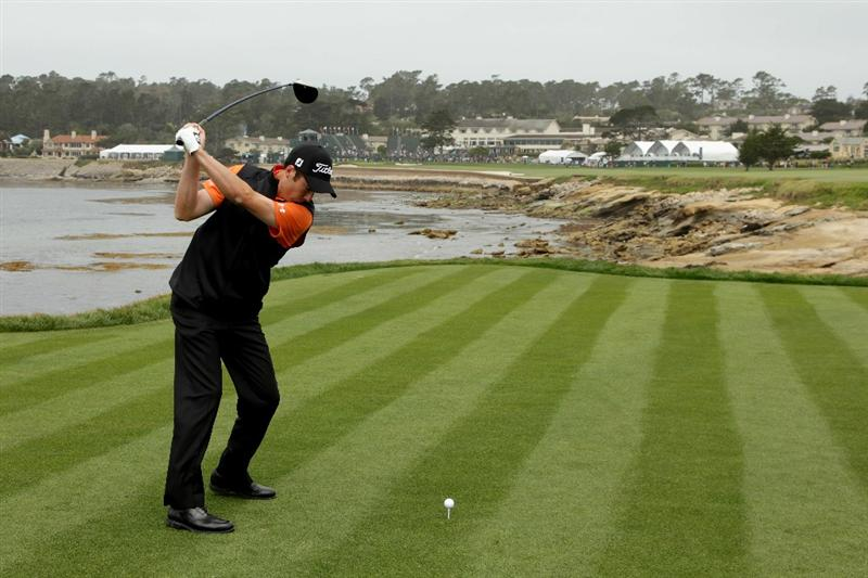 PEBBLE BEACH, CA - JUNE 15:  Ross Fisher of England plays a tee shot during a practice round prior to the start of the 110th U.S. Open at Pebble Beach Golf Links on June 15, 2010 in Pebble Beach, California.  (Photo by Andrew Redington/Getty Images)