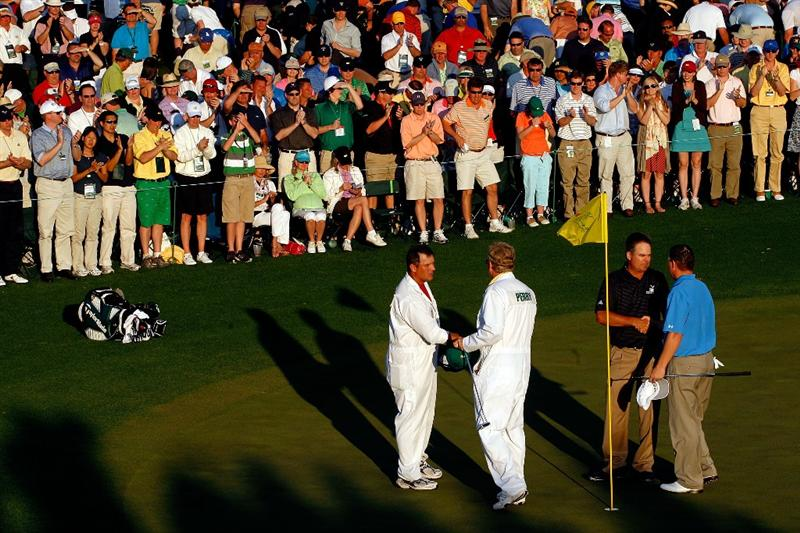 AUGUSTA, GA - APRIL 11:  Kenny Perry (L) shakes hands with Chad Campbell on the 18th hole during the third round of the 2009 Masters Tournament at Augusta National Golf Club on April 11, 2009 in Augusta, Georgia.  (Photo by Jamie Squire/Getty Images)