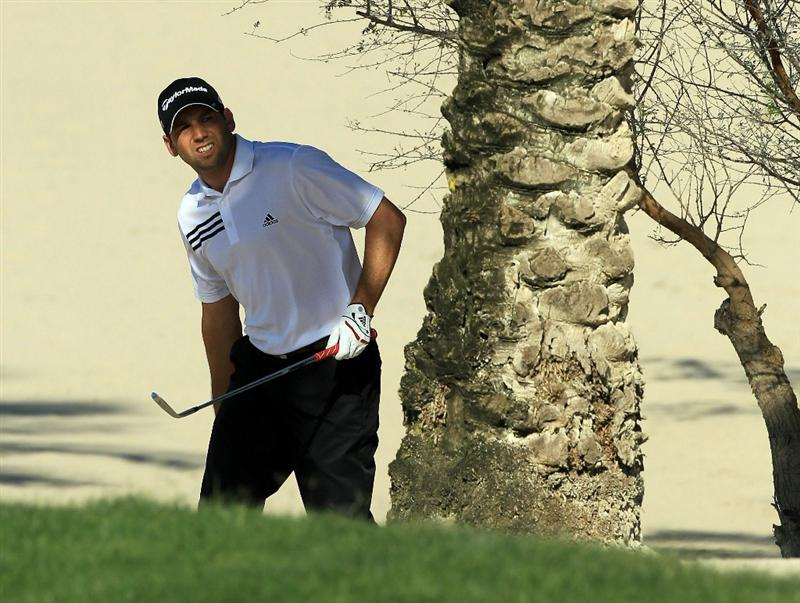 DUBAI, UNITED ARAB EMIRATES - FEBRUARY 12:  Sergio Garcia of Spain plays his second shot from the sand on the 14th hole during the third round of the 2011 Omega Dubai Desert Classic on the Majilis Course at the Emirates Golf Club on February 12, 2011 in Dubai, United Arab Emirates.  (Photo by David Cannon/Getty Images)