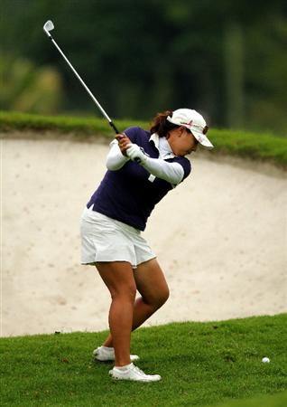 KUALA LUMPUR, MALAYSIA - OCTOBER 22:  Jee Young Lee of Korea Republic plays her 2nd shot on the 9th hole during Round One of the Sime Darby LPGA on October 22, 2010 at the Kuala Lumpur Golf and Country Club in Kuala Lumpur, Malaysia. (Photo by Stanley Chou/Getty Images)
